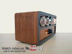 Nixie tube clock with a dekatron tube in teak wooden c